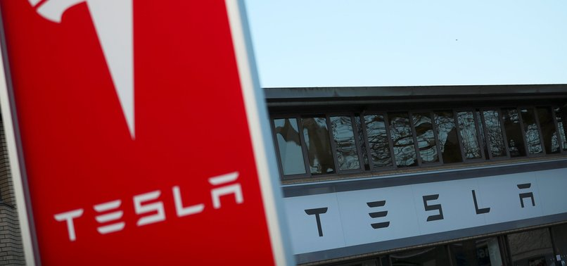 TESLA'S QUARTERLY LOSS SKYROCKETS TO RECORD $675 MILLION IN Q4