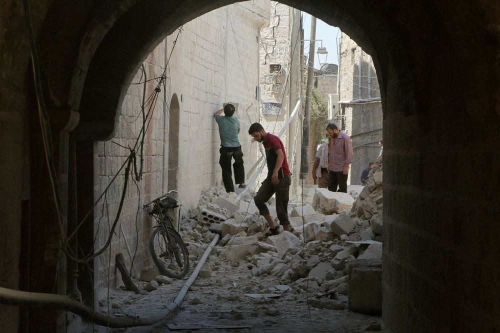 Residents inspect their damaged homes after an airstrike on the opposition-held part of Aleppo.
