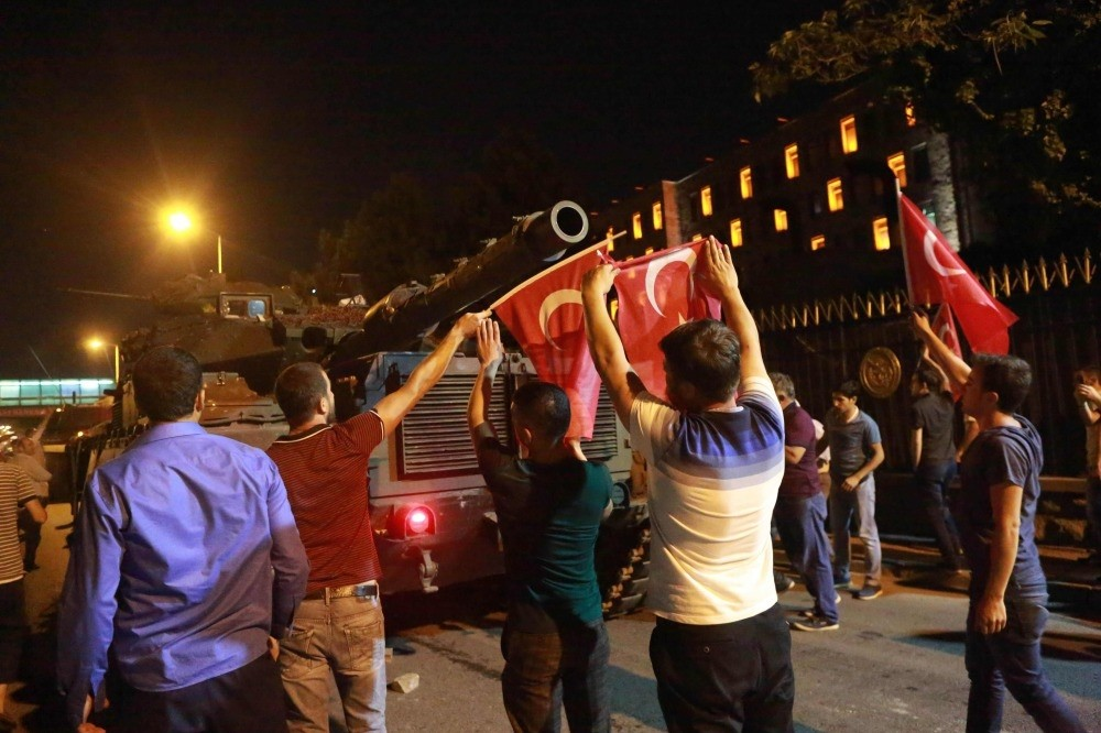 People stand up against tanks manned by coup troops in the capital Ankara. Adil u00d6ksu00fcz was captured in a main air base in the city after the coup attempt.