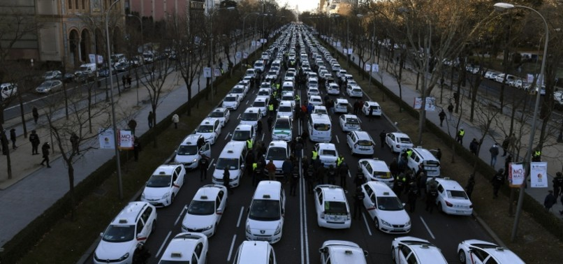 WEEKLONG TAXI DRIVER PROTESTS AGAINST UBER BRING TRAFFIC TO STANDSTILL IN MADRID