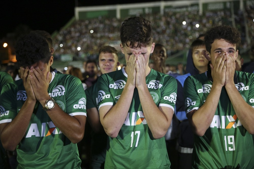 Players of Chapecoense football club participate in a tribute to their fellow players killed in a plane crash at the club's stadium in Chapeco, Santa Catarina, Brazil.