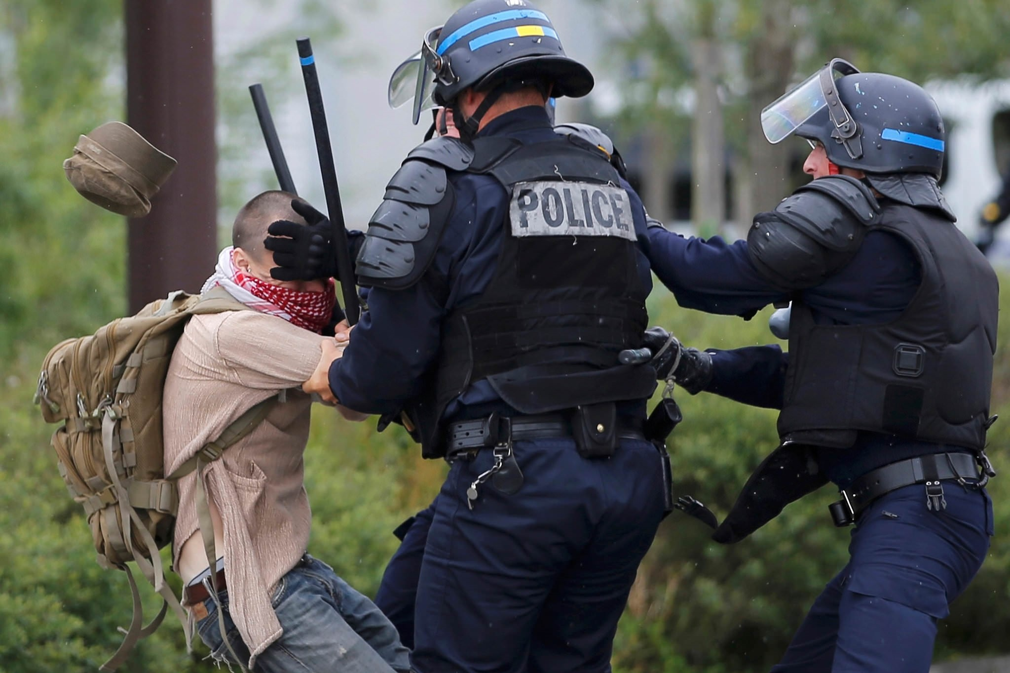 French police apprehend a man during a demonstration to protest the government's proposed labour law reforms in Nantes, France, May 26, 2016. (Reuters Photo)