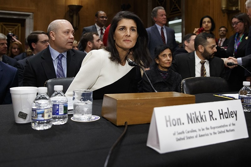 UN Ambassador-designate, South Carolina Gov. Nikki Haley, accompanied by her husband Michael, left, prepares to testify on Capitol Hill in Washington on Wednesday, Jan. 18, 2017. (AP Photo)