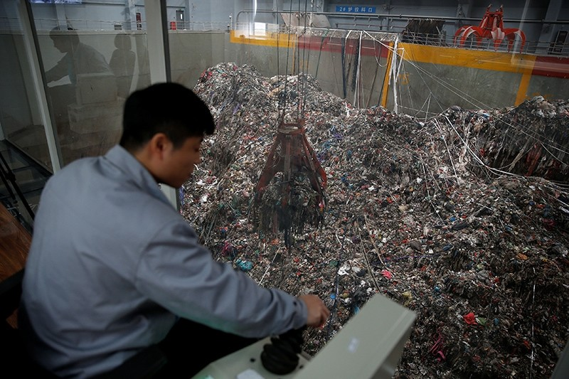 An employee works inside a newly launched waste-to-energy plant by Suzhou Wujiang Everbright Environmental Energy Ltd in Wujiang of Suzhou, Jiangsu province, China (Reuters Photo)