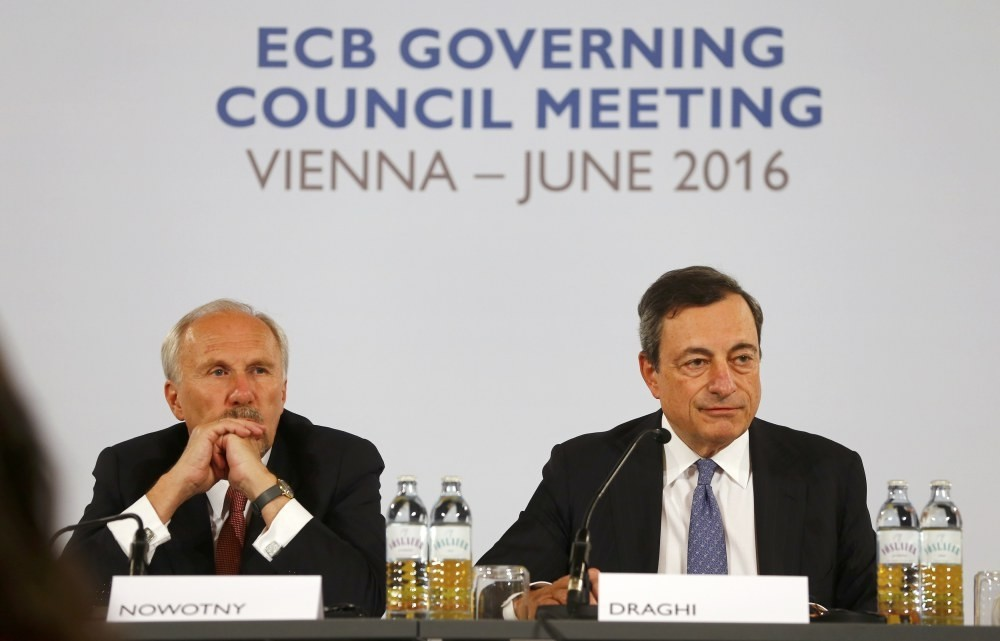 Governor of the Austrian National Bank and European Central Bank (ECB) Governing Council member Ewald Nowotny (L) and ECB Governor Draghi attend a news conference in Hofburg palace in Vienna, Austria, on June 2.