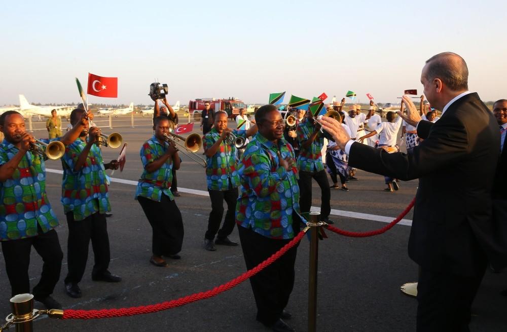 President Recep Tayyip Erdu011fgan (R) listening to musicians during his welcome ceremony, in Dar es Salaam, Tanzania, Jan. 22.