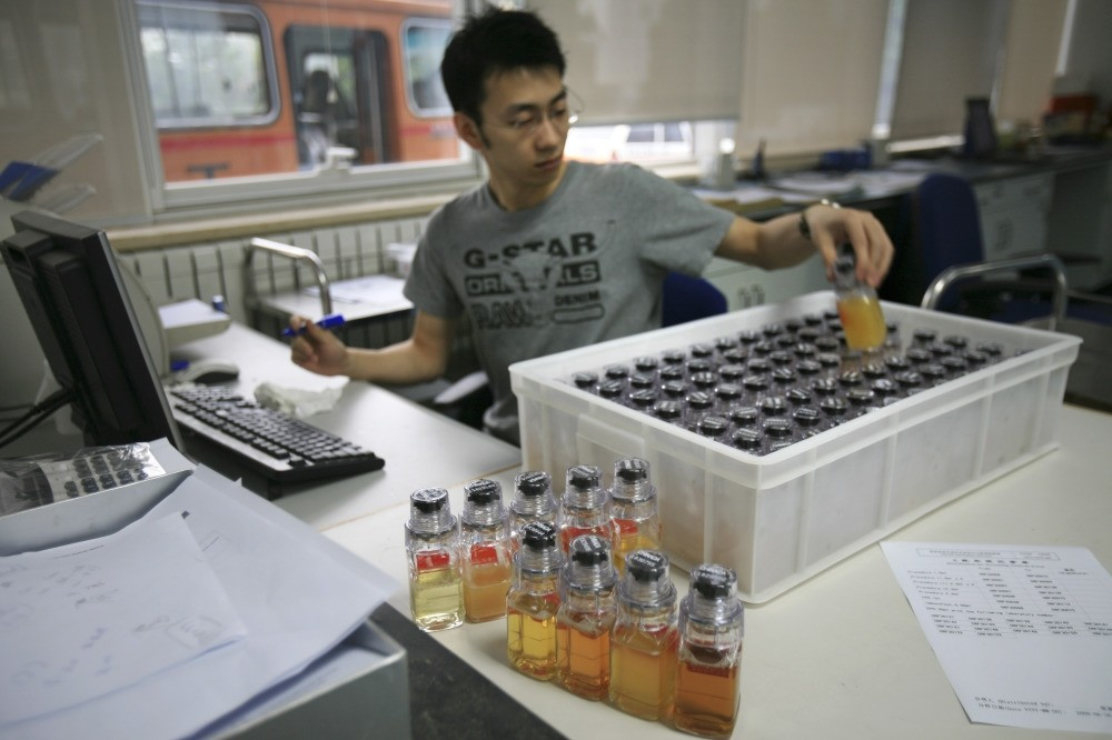 Urine samples from Chinese athletes are recorded upon arriving at the Chinese Anti-Doping Agency in Beijing in 2008. The IOC said athletes caught for doping in retesting of samples from the 2008 Olympics.