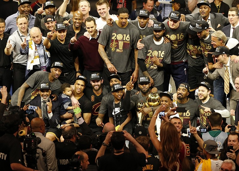 Cleveland Cavaliers pose for a team photo with the NBA Finals Championship Trophy after defeating the Golden State Warriors in NBA Finals game seven (EPA)