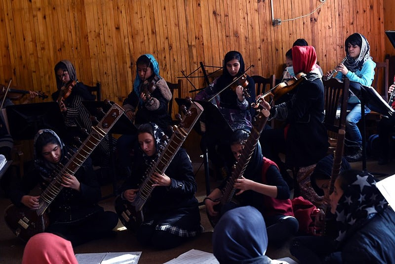 In this photograph taken on January 8, 2017, Afghan music students play during a rehearsal at The Afghanistan National Institute of Music in Kabul. (AFP Photo)