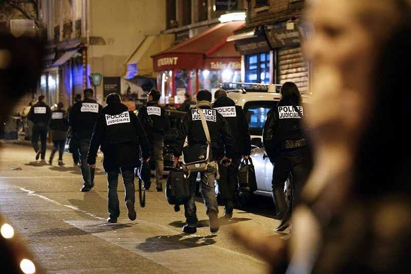 This file photo taken early on Nov. 14, 2015 shows the criminal police arriving at the site of an attack in Paris. (AFP Photo)