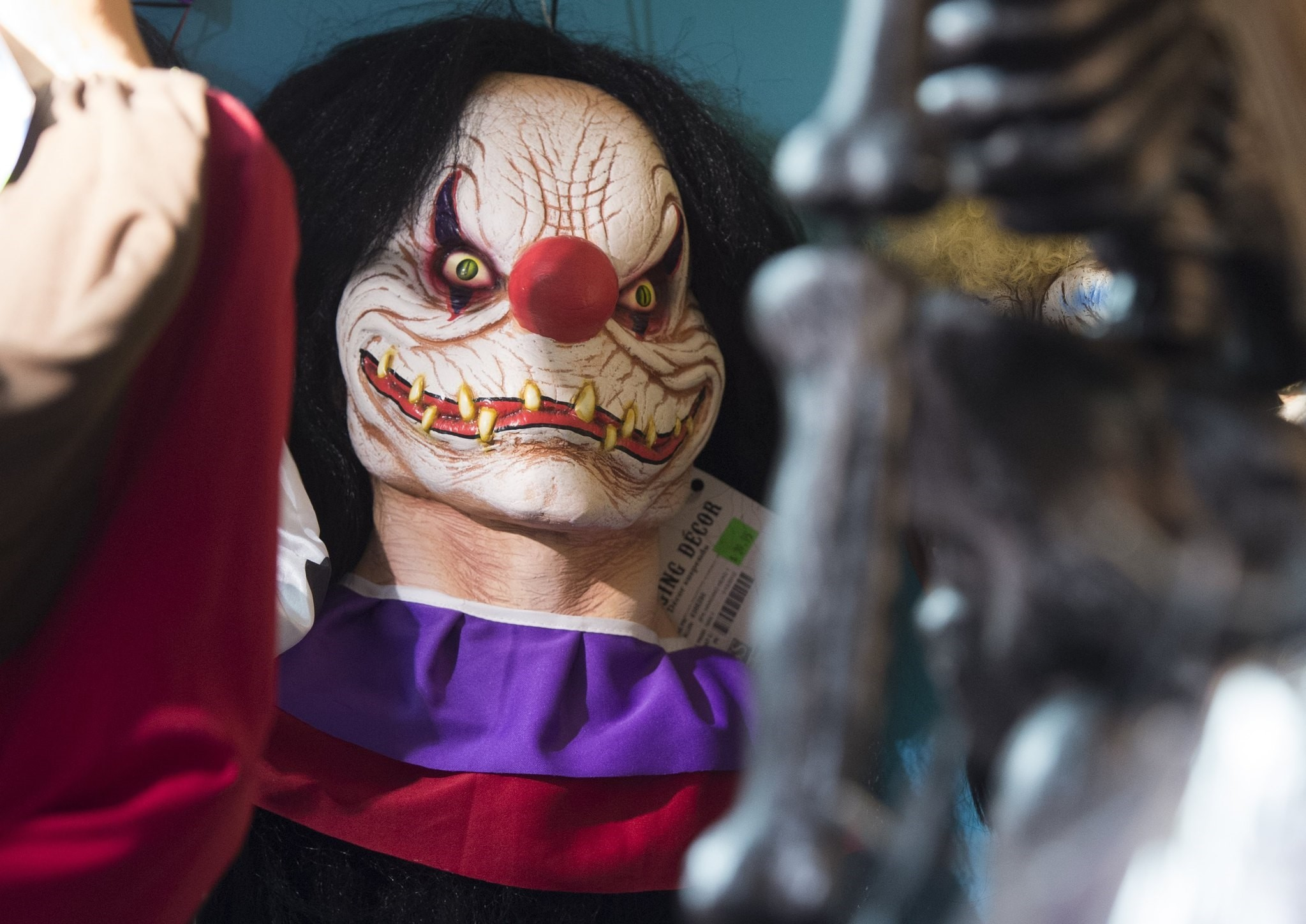 Halloween costumes and props, including a ,scary, clown mask, are seen for sale at Total Party, a party store, in Arlington, Virginia, October 7, 2016. (AFP Photo)