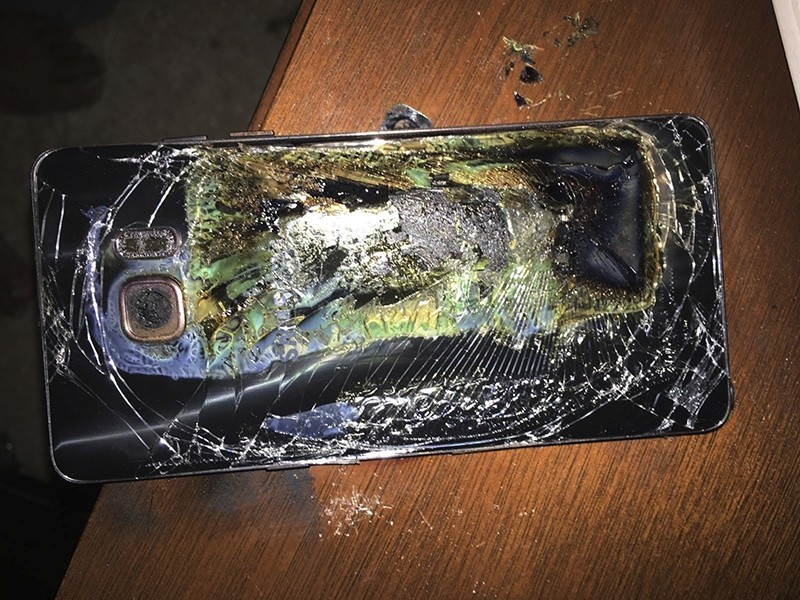 This Sunday, Oct. 9, 2016, photo shows a damaged Samsung Galaxy Note 7 on a table in Richmond, Va., after it caught fire earlier in the day. (AP Photo)