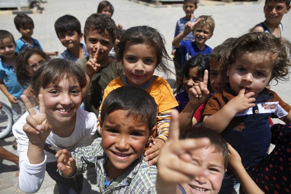 Children play at a Syrian refugee camp in u00d6ncu00fcpu0131nar in southeastern Turkey. Turkey hosts the largest number of refugees from the war-torn country.