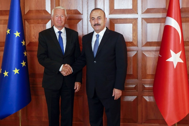 Foreign Minister Mevlu00fct u00c7avuu015fou011flu (R) and Secretary General of the Council of Europe Thorbjorn Jagland pose as they shake hands prior to their meeting in Ankara August 3, 2016.  AFP PHOTO