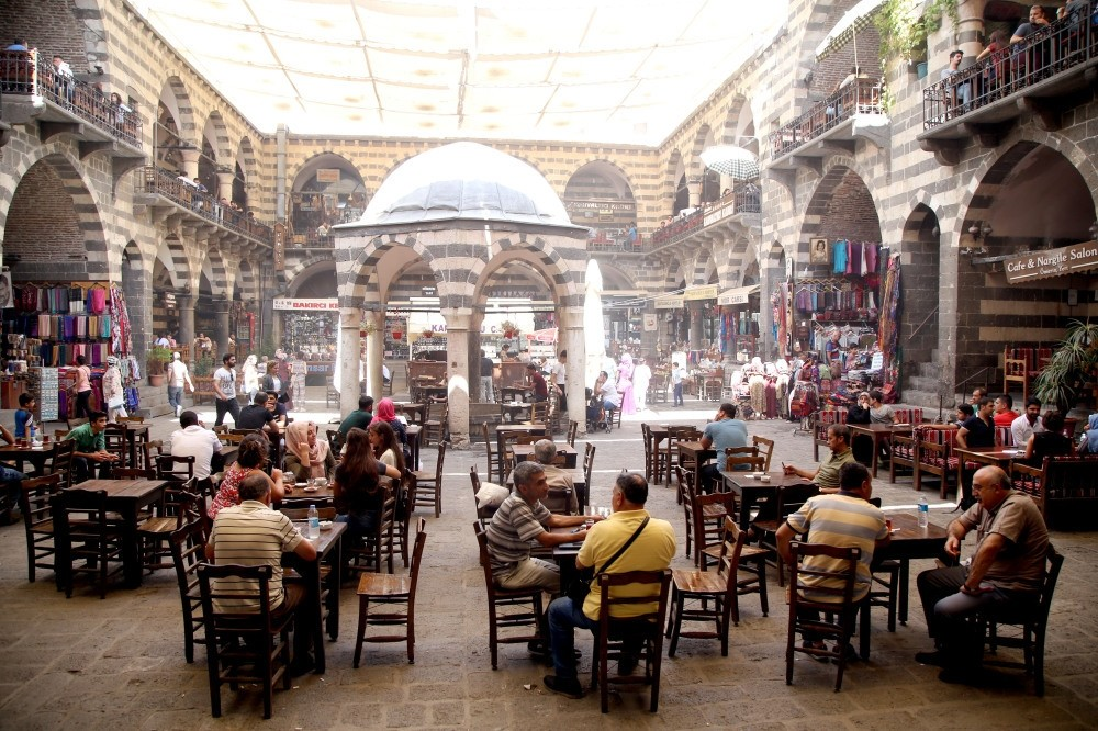 This file photo shows a group of artisans sitting in a bazaar in Sur, Diyarbaku0131r. The recently announced investment and development initiative is causing quite a stir in the business world.