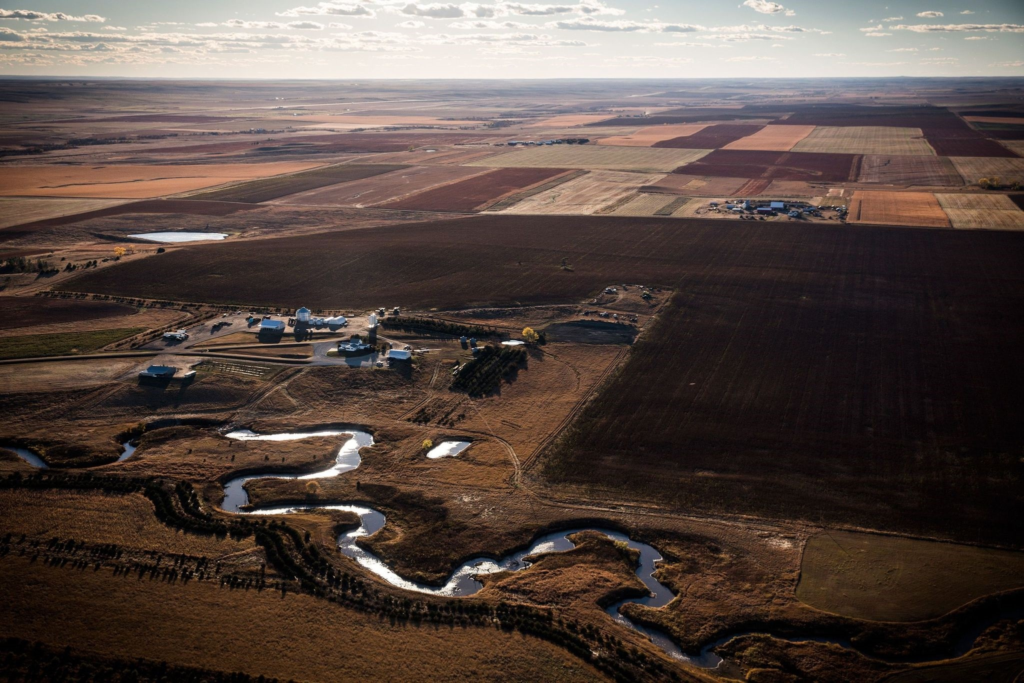 This photo taken on Oct 12, 2014 shows a creek weaving through the rolling hills of South Dakota where the proposed Keystone XL pipeline would pass. (AFP Photo)