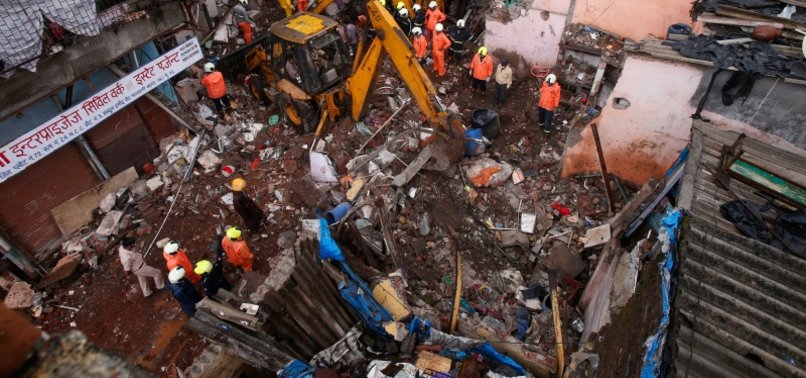 3-STORY BUILDING COLLAPSES IN INDIA IN HEAVY RAIN, KILLS 11