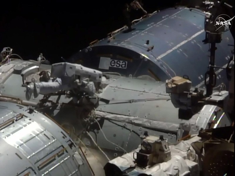 This NASA TV video grab shows US astronaut Kate Rubins viewed near the docking port on August 19, 2016 at the International Space Station. (AFP Photo / NASA TV)