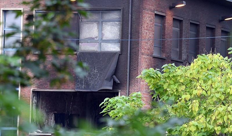 Damage can be seen at the building of the National Criminology Lab in Brussels on Monday, Aug. 29, 2016 (AP Photo)