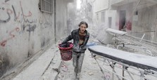 Assad regime drops barrel bombs on opposition areas