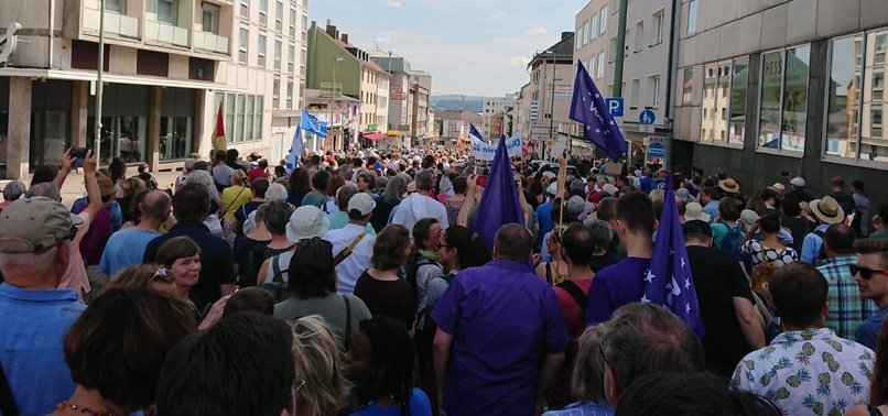 THOUSANDS OF PEOPLE GATHER IN GERMAN CITY OF KASSEL TO PROTEST FAR-RIGHT RALLY
