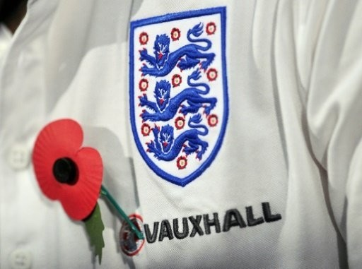 The Sun said FIFA had refused to let England and Scotland display poppies on their shirts during the game because it would be a political statement. (AFP Photo)