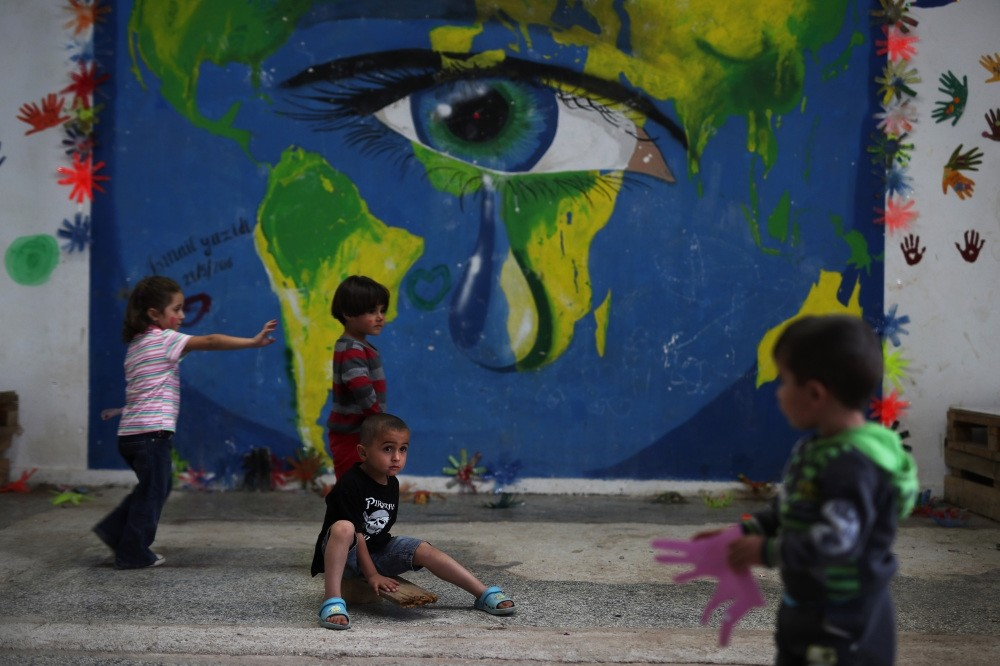 Children playing in front of a mural at Ritsona refugee camp, north of Athens, Sept. 13, 2016.