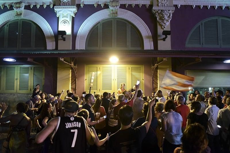 People celebrate after learning that President Barack Obama commuted the sentence for Puerto Rican nationalist Oscar Lopez Rivera, in San Juan, Puerto Rico (AP Photo)