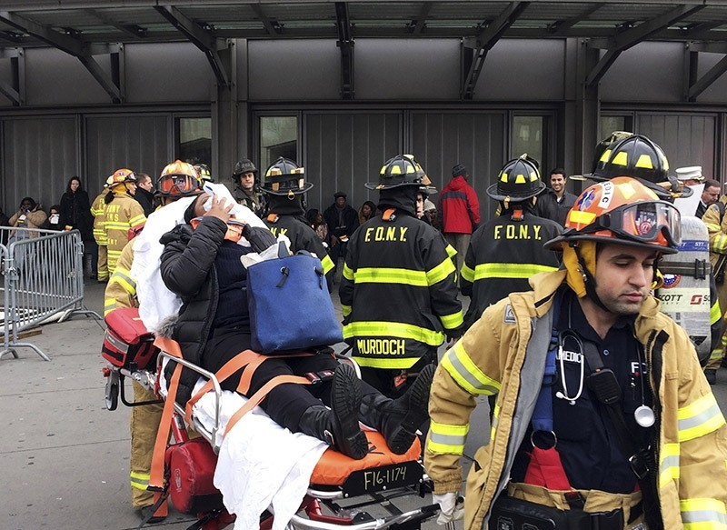 An injured passenger is taken from Atlantic Terminal in the Brooklyn borough of New York after a Long Island Rail Road train hit a bumping block, Wednesday, Jan. 4, 2017. (AP Photo)