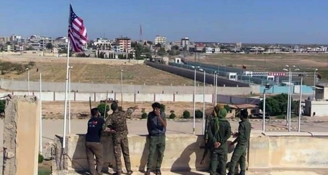 The American flag was flown at a YPG base in northern Syria's Tal Abyad town.
