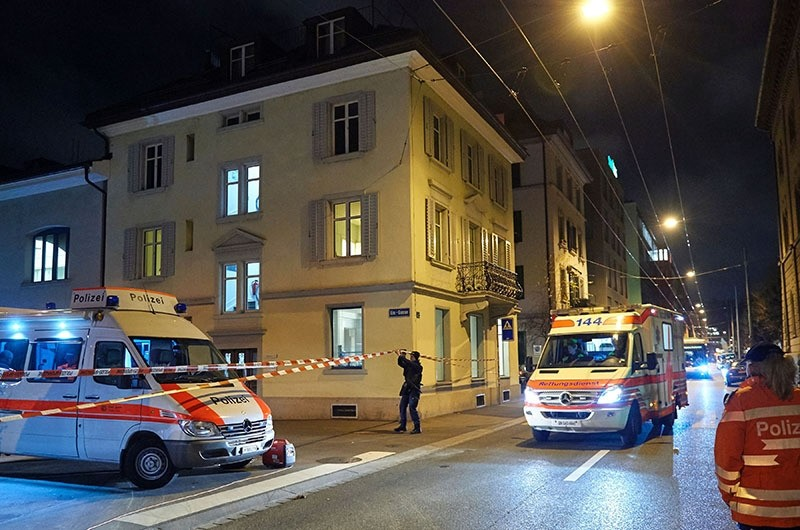 Ambulance and police cars are seen outside a Muslim prayer hall, central Zurich, on December 19, 2016, after three people were injured by gunfire. (AFP Photo)