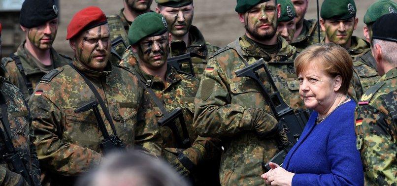 MERKEL HIGHLIGHTS RUSSIA THREAT ON NATO FORCE VISIT