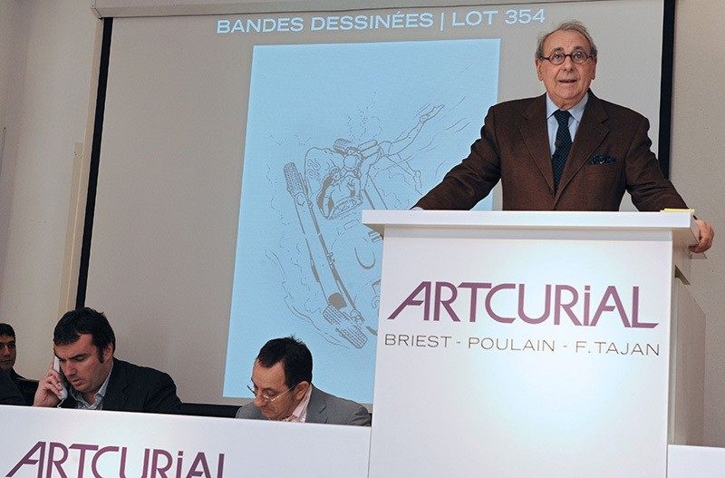 This file photo taken on November 22, 2008 shows an auctioneer leading an auction presenting comic-books by French Jean Graton at the Artcurial auction house in Paris (AFP Photo)