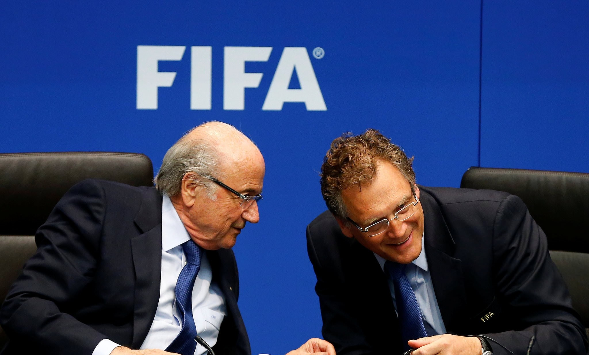 FIFA President Sepp Blatter (L) talks to FIFA Secretary General Jerome Valcke during a news conference after a meeting of the FIFA executive committee in Zurich March 21, 2014. (REUTERS Photo)
