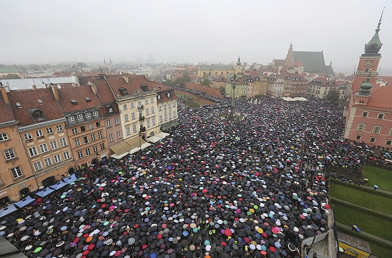 A sea of thousands of umbrellas of women and men participating in a nationwide Black Monday strike to protest a legislative proposal for a total ban on abortion, in downtown Castle Square is pictured in Warsaw, Poland, Oct. 3, 2016. (AP Photo)