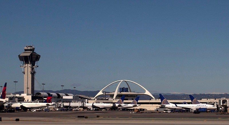 United Airlines planes are seen in the foreground of the Los Angeles International Airport (LAX) and its air traffic control tower on February 20, 2013. Picture taken on February 20, 2013 (Reuters File Photo)