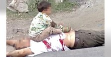 Photo of toddler sitting on slain grandpa angers Kashmiris