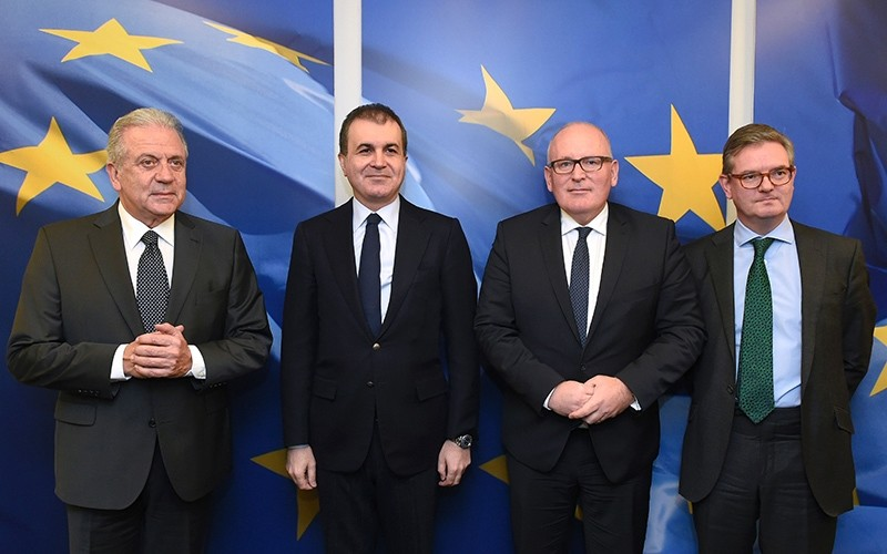 EU Commissioner of Migration Avramopoulos,Turkey's EU Minister u00c7elik, EU Commission First Vice-President Timmermans and EU Commissioner for Security Union King at the EU headquarters in Brussels on November 30, 2016. (AFP Photo)