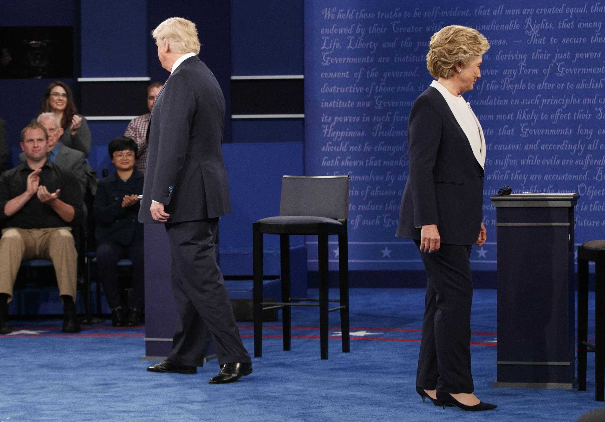 Donald Trump and Hillary Clinton walking to their chairs as they arrive for the second presidential debate at Washington University in St. Louis, Oct. 9, 2016.