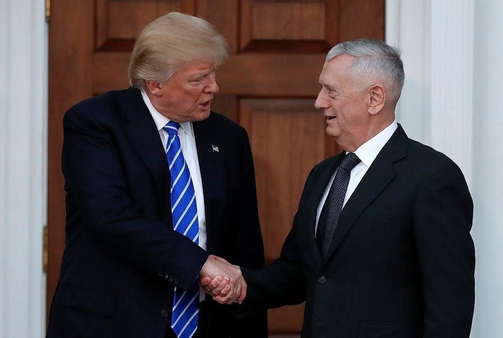 President-elect Donald Trump shakes hands with retired Marine Corps Gen. James Mattis (AP Photo)