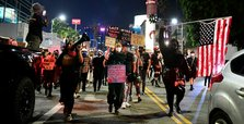 Protesters defy second night of curfew in Breonna Taylor protest