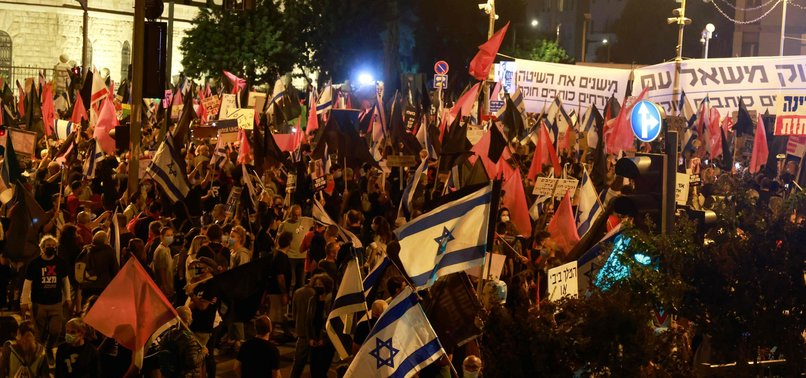 THOUSANDS OF ISRAELIS POUR INTO JERUSALEM STREETS TO DEMAND DEPARTURE OF PM NETANYAHU