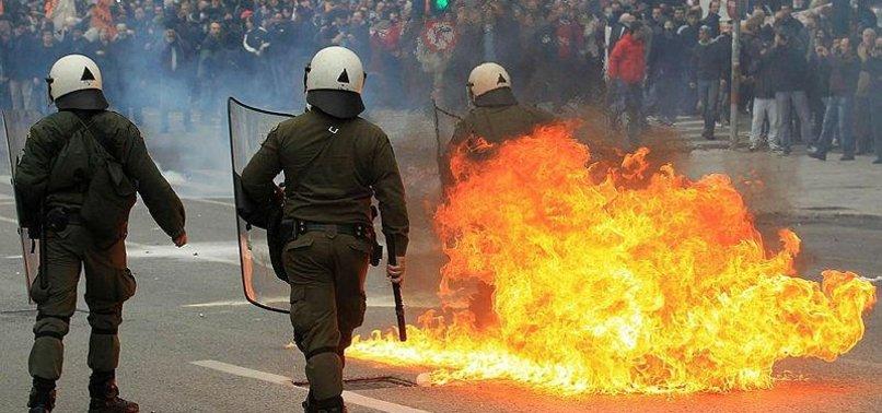 TURKEY ASKS GREECE TO ARREST PROTESTERS FOR BURNING FLAG