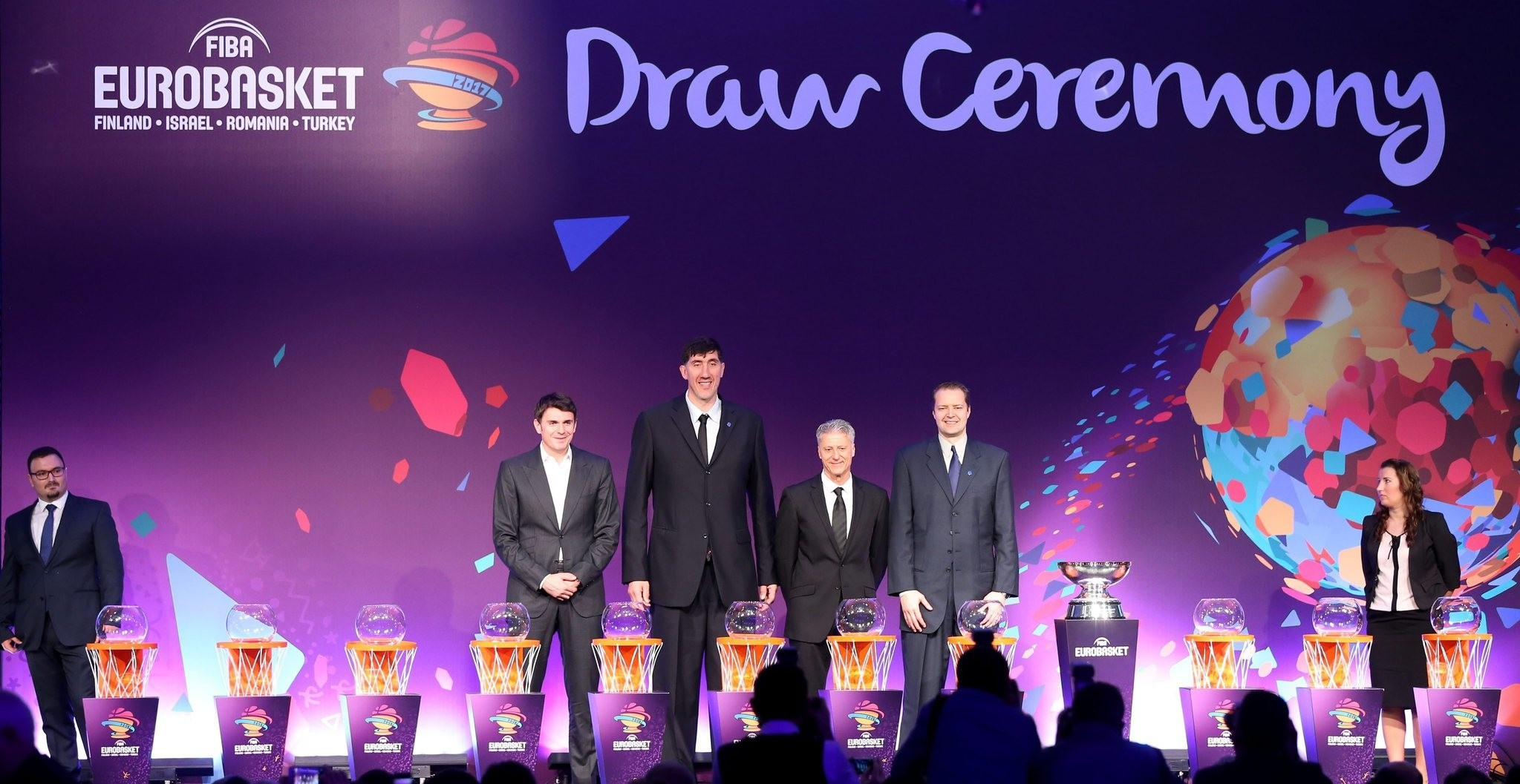 Former basketball players Turkish Mirsad Turkcan, Romanian Gheorghe Muresan, Israeli Mickey Berkowitz , Finnish Hanno Mottola pose for media during the draw of FIBA EuroBasket 2017 in Istanbul. (EPA Photo)