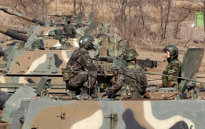 South Korean Army soldiers sit on their K-9 self-propelled artillery. (AP Photo)