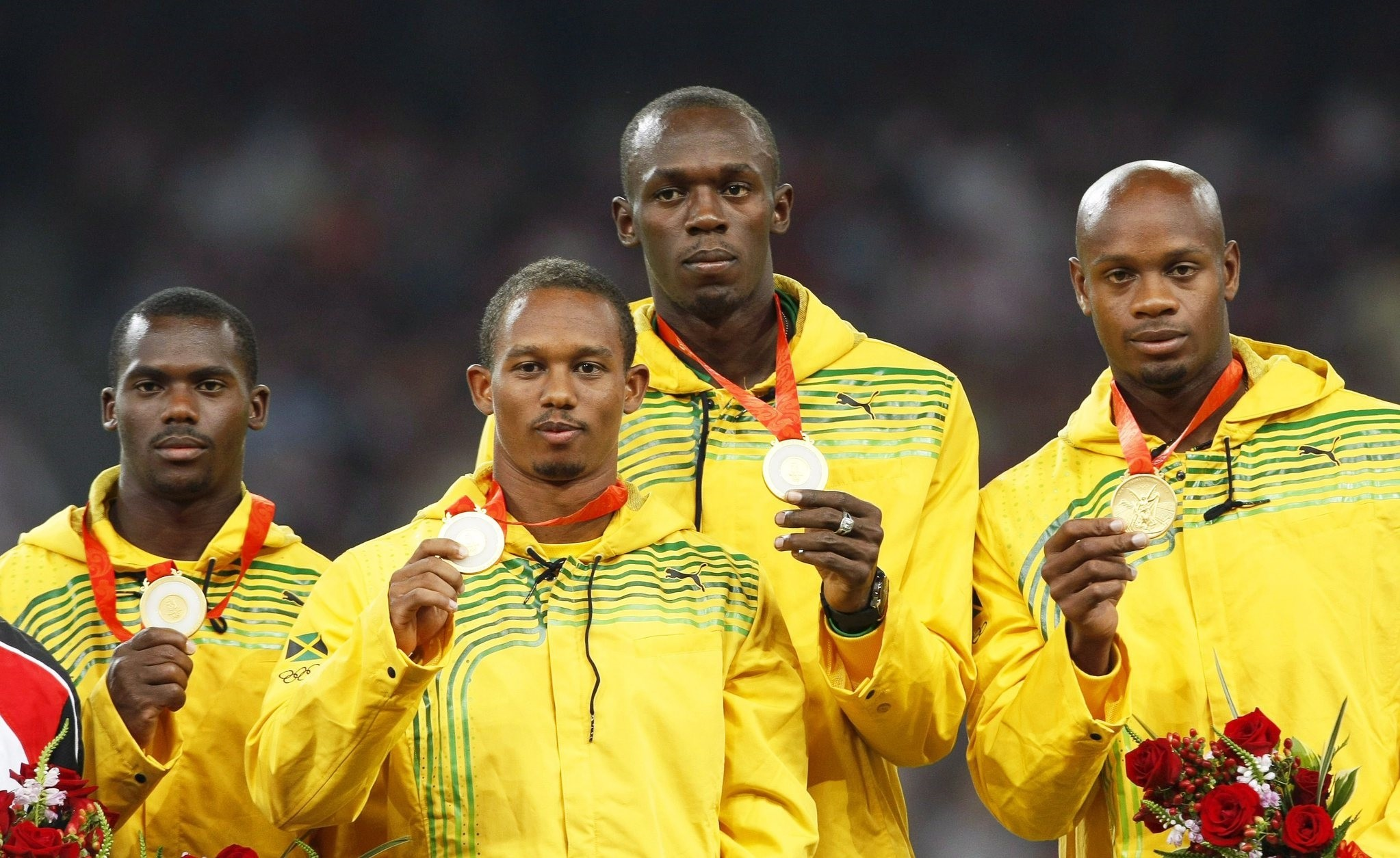 A file picture dated 23 August 2008 of Jamaica's (L-R) Nesta Carter, Michael Frater, Usain Bolt, and Asafa Powell posing with their gold medals. (EPA Photo)