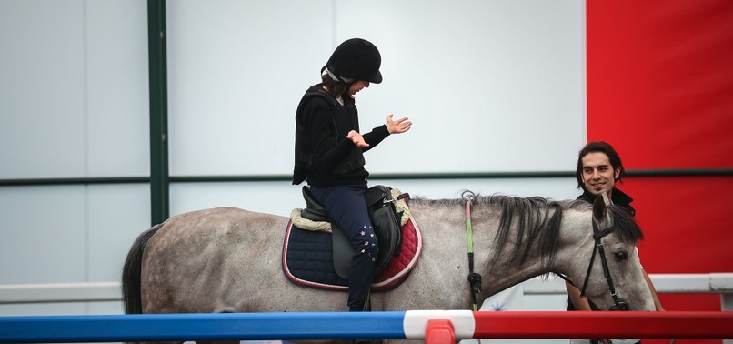 HORSE THERAPY OFFERS DISABLED CHILDREN NEW FORM OF REHABILITATION