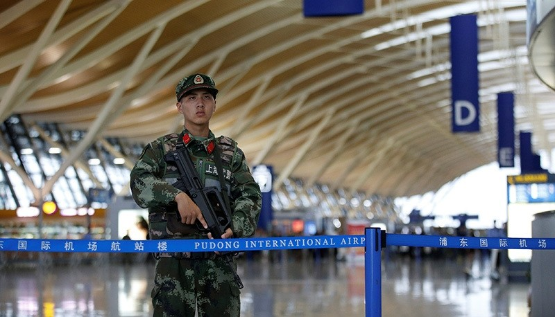 A paramilitary policeman guards near the site of a blast at a terminal in Shanghai's Pudong International Airport, China, June 12, 2016 (Reuters Photo)