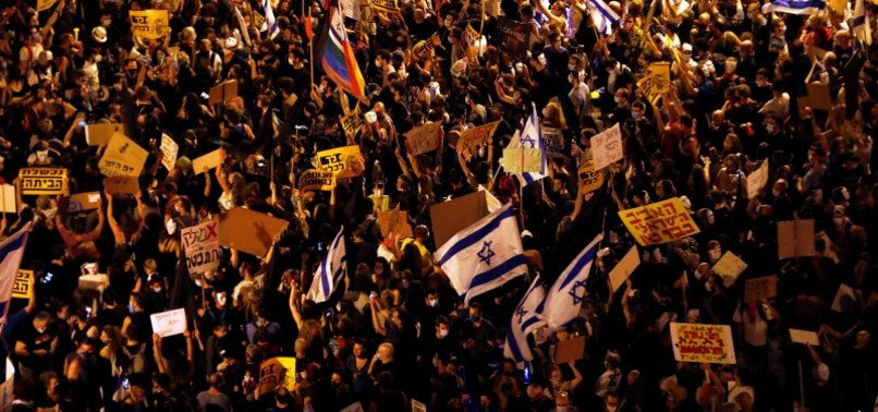 THOUSANDS TAKE TO ISRAELI STREETS TO CALL FOR NETANYAHUS RESIGNATION