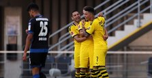 Jadon Sancho hat-trick keeps Dortmund in title hunt